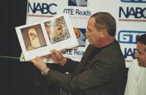 Coach Charlie Brock reading a children's book