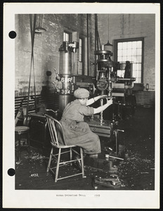 Woman operating drill