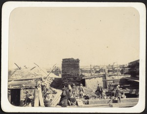 Construction of new Legation; workers in foreground