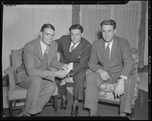 Dom DiMaggio with two men in hotel room