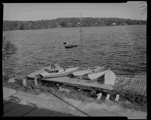Damaged dock with sailboats