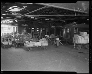 US Mail carts at train track depot